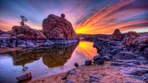 sunset and rock reflected balanced in water, like the balance after jet lag treatment